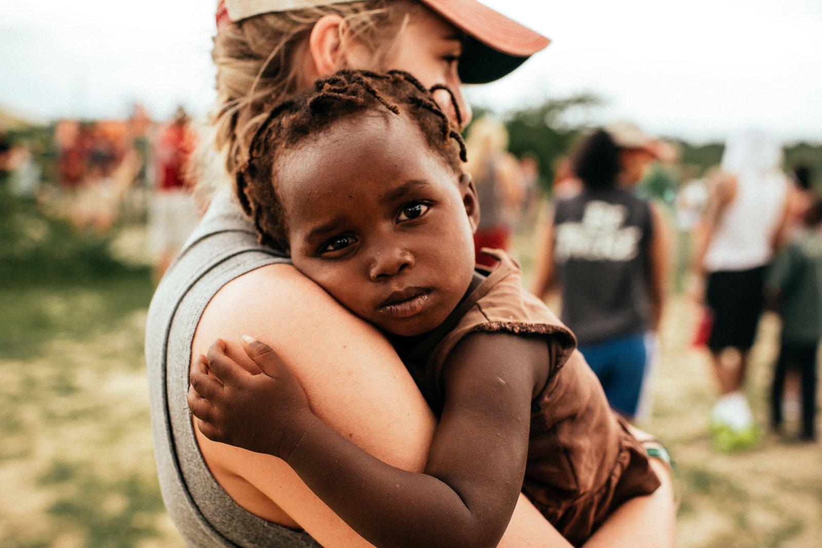 girl-holding-child.jpg
